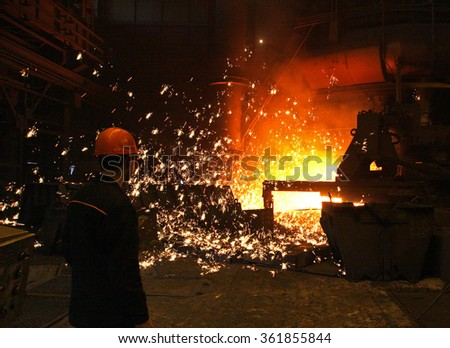working in the open-hearth workshop of metallurgical plant