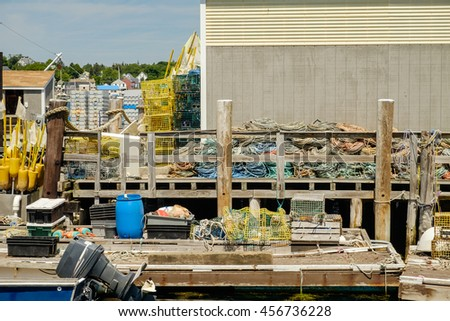 Working Lobster dock in Maine with traps and buoys - stock photo