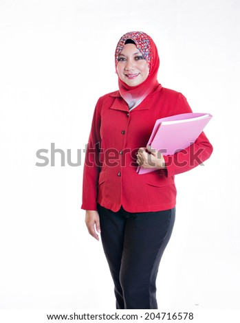 Working Malaysian lady holding a file and looking at the camera - stock photo