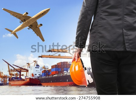 working man and commercial ship on port and air cargo plane flying above use for water and air transport,logistic import export industry - stock photo