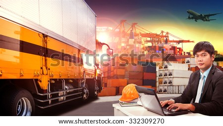 working man and container truck in shipping port ,container dock and freight cargo plane flying above use for transportation and logistic industry - stock photo