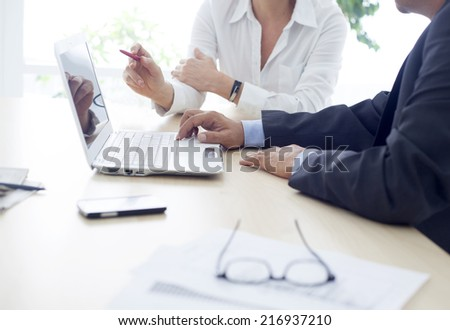 Working man and woman in the office  - stock photo