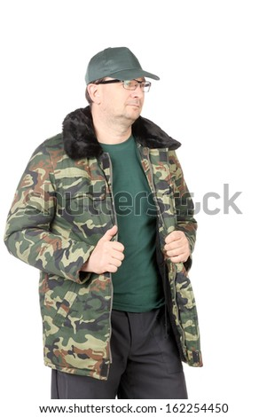 Working man in military workwear. Isolated on a white background.