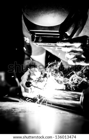 Working man, welding, sparks and smoke. People, industrial. - stock photo