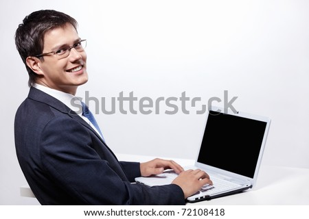 Working man with a laptop on a white background - stock photo