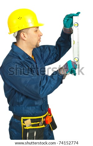 Working mid adult man measure with bubble level isolated on white background