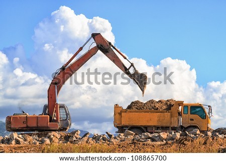 Working Navvy and Dumper - stock photo