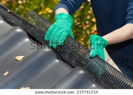 Working next to roof during autumn time - stock photo