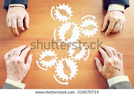 Working of the team like a mechanism. Abstract conceptual image - stock photo