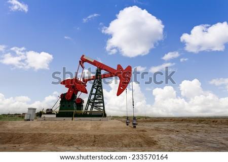 Working oil pump jacks on a oil field - stock photo