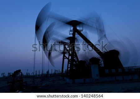 Working oil pump silhouette - stock photo