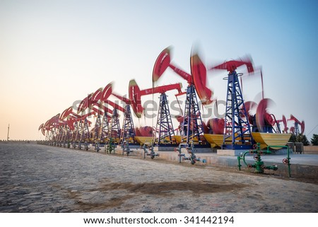 working oil-rig in oilfield in clear sky - stock photo