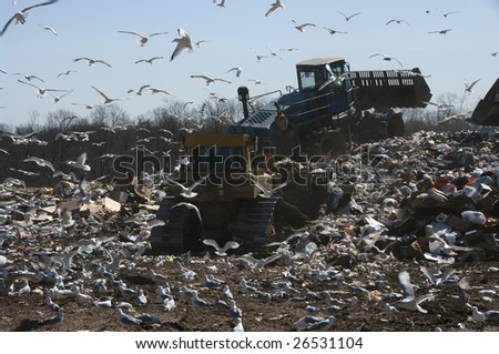 Working on a landfill, the pile is getting bigger everyday. - stock photo