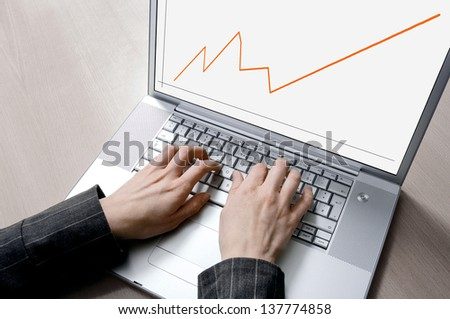 Working on a laptop - stock photo