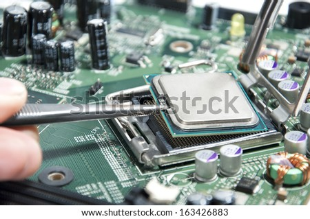 Working on computer motherboard