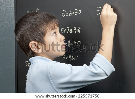 Working on his times tables. - stock photo