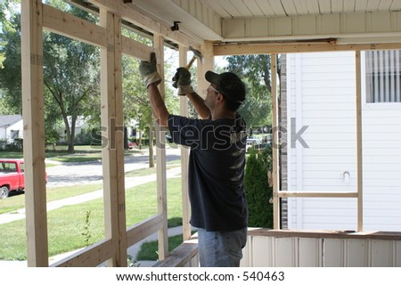 Working on new construction porch - stock photo