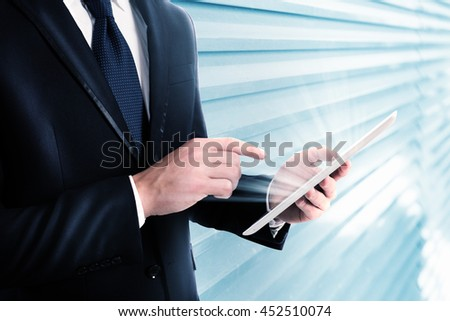 Working on tablet - stock photo
