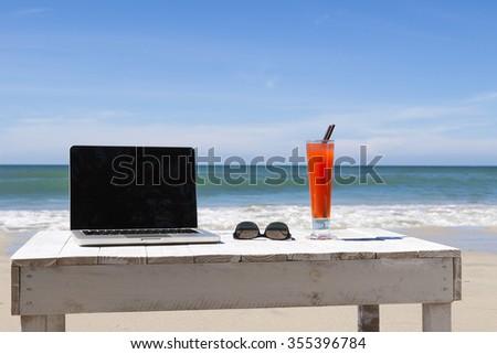 Working on the beach - stock photo