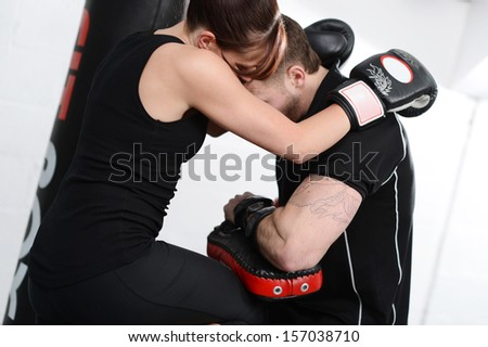 Working out with mitts or gloves and pads - stock photo