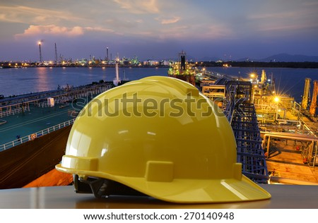 Working outdoors should use safety helmets for safe harbors, oil refineries, construction sites. - stock photo