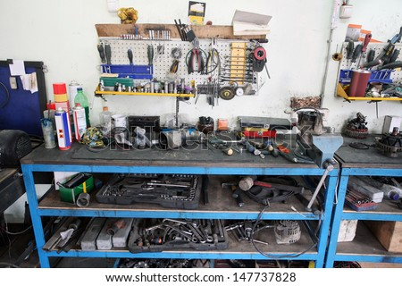Working place at a repair garage - stock photo