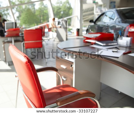 Working place in the office with red chair.