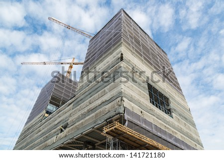 Working place with skyscraper under construction - stock photo