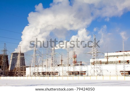 Working power station near the factory making the chemical industry (a winter season) - stock photo