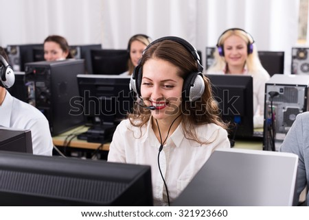 Working process of successful call center team at office and beautiful woman - stock photo