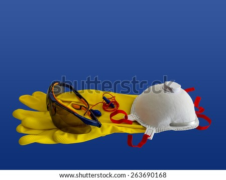 Working protection set including pair of gloves, glasses, respirator and ear plugs  - stock photo
