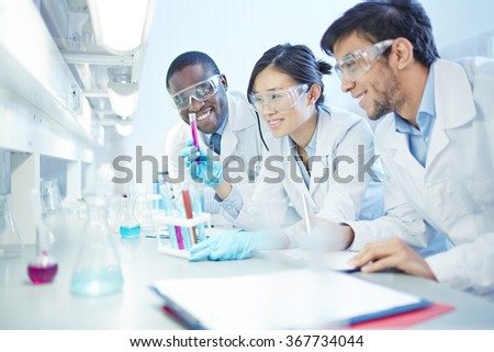 Working scientists - stock photo
