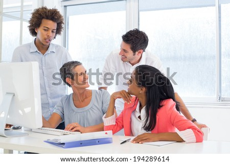 Working smiling and interacting cheerfully in the office - stock photo