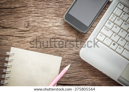 Working space. Laptop, notebook, smartphone on wooden desk. business concept. - stock photo