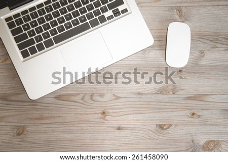 Working table overhead view, wooden table in vintage tone. - stock photo