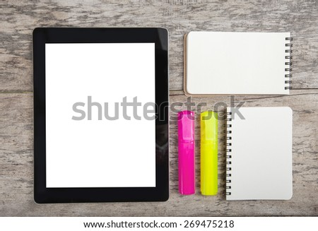 working table with tablet marker and note paper - stock photo