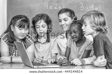 Working together at elementary school. Integration and multi ethnic concept. - stock photo