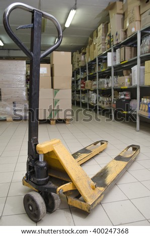 working tool of the loader of a supermarket - stock photo