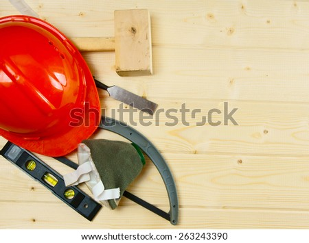 Working tools. A hammer, a chisel, a corner and other tools on a wooden background. - stock photo