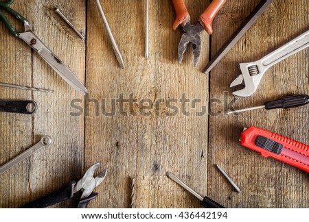 working tools frame with wrench scissors screwdriver and pliers on wooden desks with copy - Wrench Picture Frame