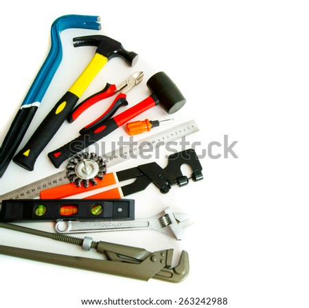 Working tools. Many working tools - saw, axe, pliers and others on white background. - stock photo