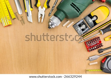 Working tools on wooden background with copy space - stock photo