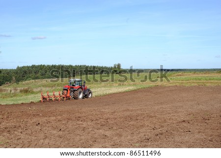 working tractor in the field