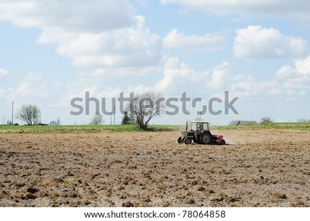 working tractor on the field