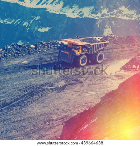 working truck in career on extraction of minerals - stock photo