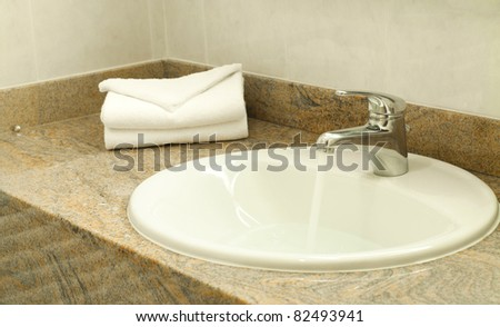 Working water faucet - stock photo