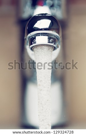 working water tap, front view - stock photo