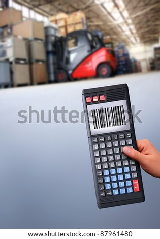 working with a modern handheld computer - stock photo