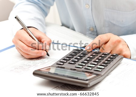 working with calculator - stock photo