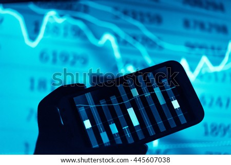 Working with digital tablet computer and smart phone with digital business strategy layer effect and the digital chart. Dark tone.